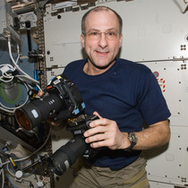 NASA Astronaut Don Pettit hold one of the Full Spectrum camera modified by Spencer's Camera & Photo.