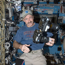 NASA Astronaut Dan Burbank hold one of the Full Spectrum camera modified by Spencer's Camera & Photo.